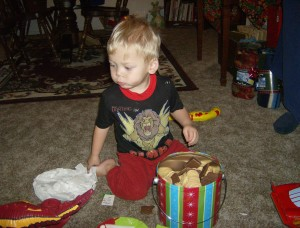 He loves cookies! Santa brought him a whole tin of them.